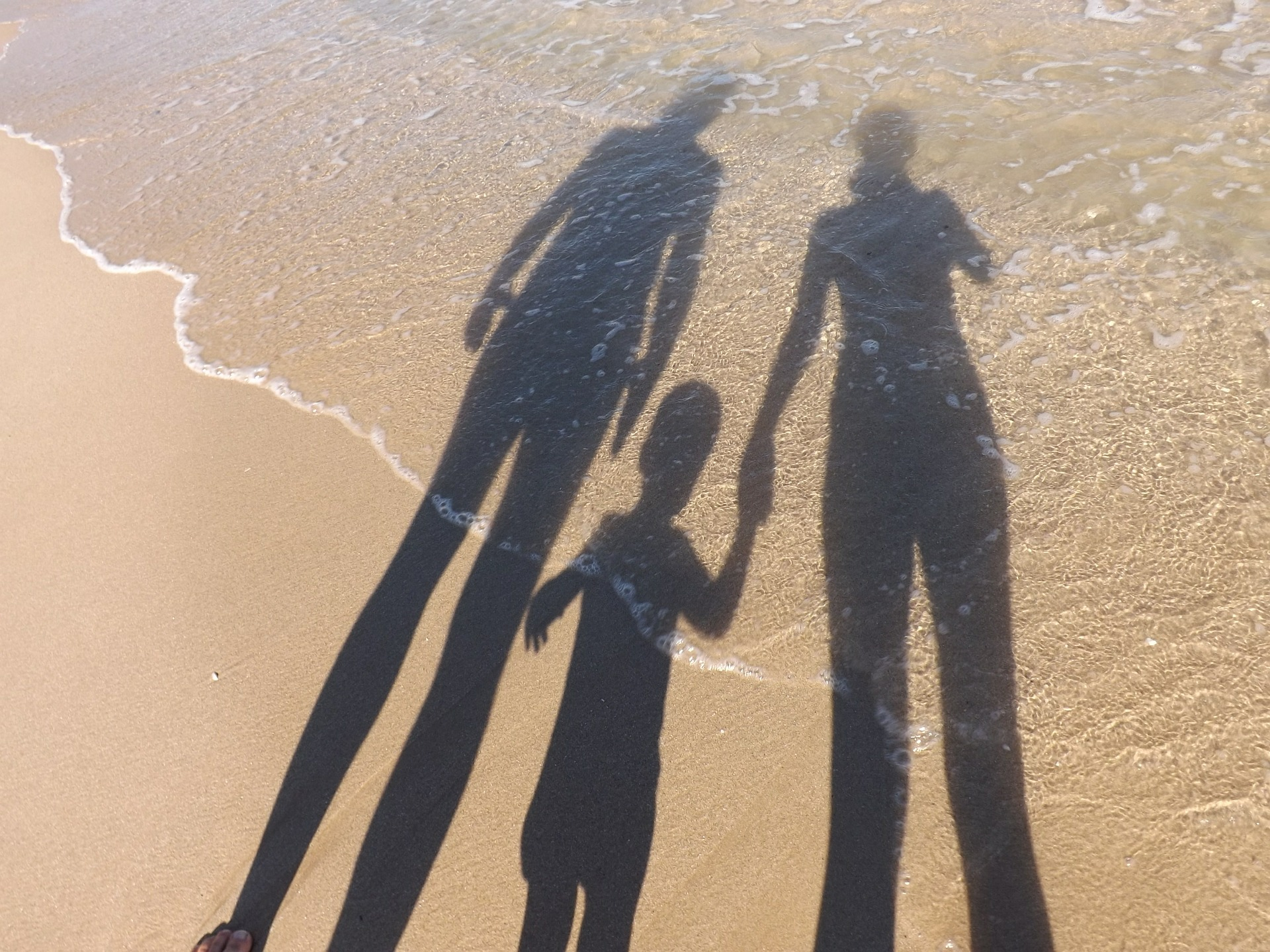 loslaten kinderen strand vakantie